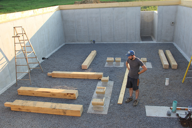 man standing thinking When a new home is being built, the question of what is the best foundation for a house will be answered by the homebuilder in consultation with the architect and homeowner.