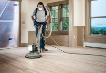 man working on the best floor buffer for home use
