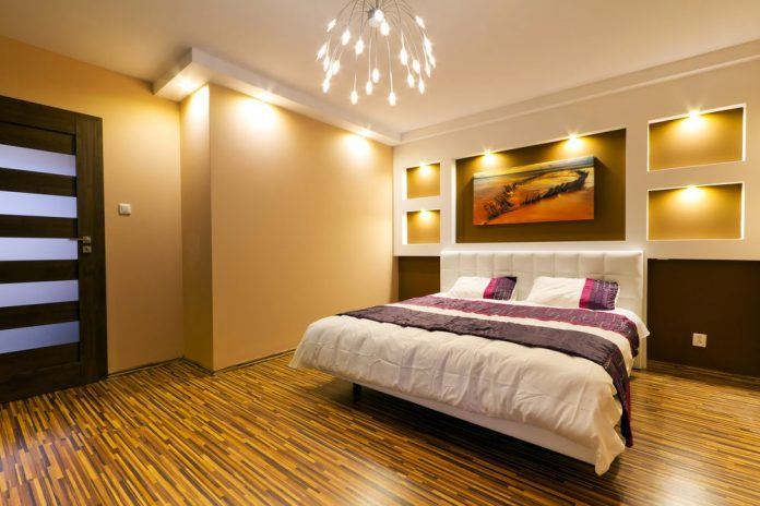 room with large bed and semi dark lighting