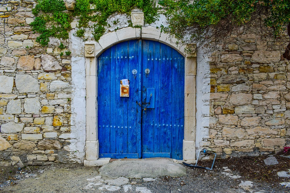 Old wooden door painted in blue