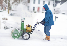 man using the snow blower