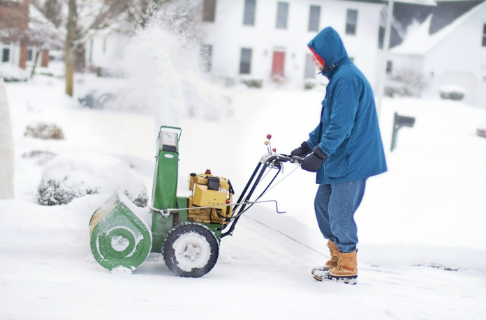 man using the snow blower
